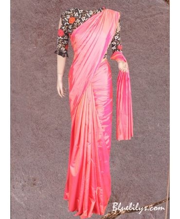 coral peach semi silk saree with black floral  embroidered blouse