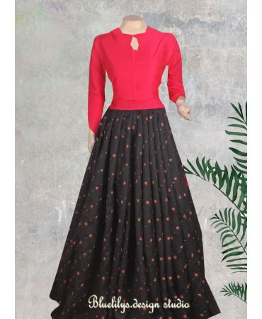 Unstitched red top with black and red embroidered raw silk skirt