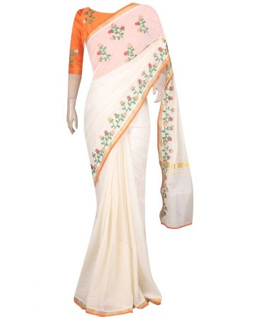 Cream color kerala saree with floral patchwork on the border