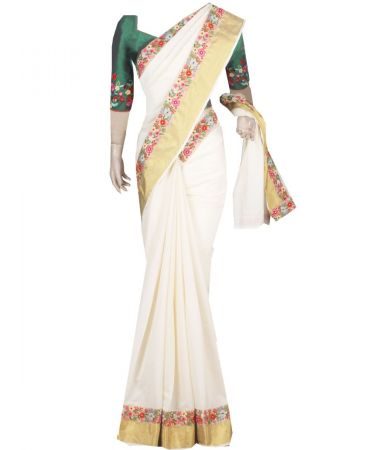 Cream color kerala saree with attached floral lace border and handworked blouse