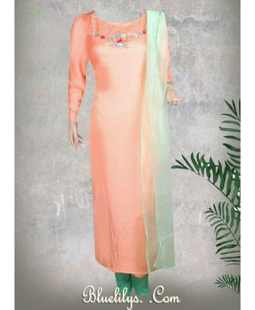 Semi jute flowy light peach suit with hand embroidery and organza dupatta