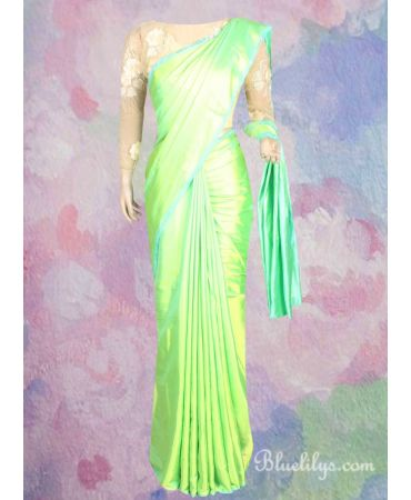 Lime shade semi jute silk saree with embroidered blouse