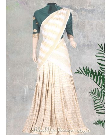 Unstitched sea green blouse with embroidery and off white brocaded halfsaree