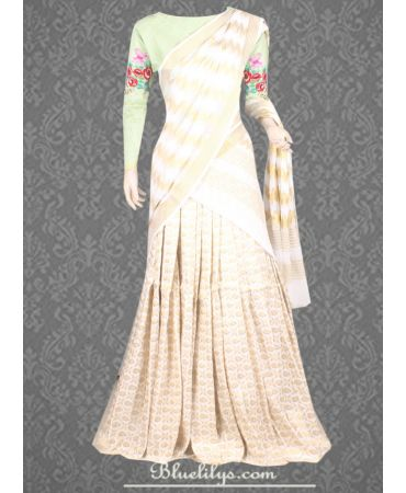 Unstitched  nile green shade and off white brocade half saree