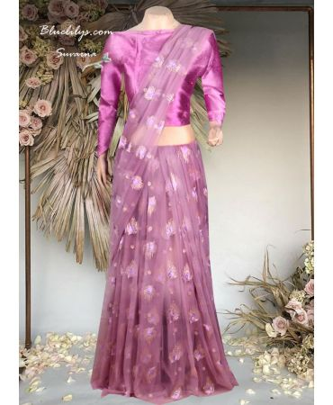 Lilac purple shade net designed  half saree with plain blouse