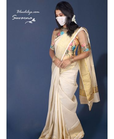 Tissue cream traditional Kerala saree with designer blouse