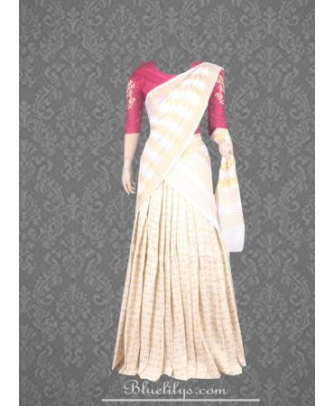 Unstitched raspberry shade blouse and brocade combination half saree