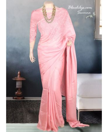 Fruit pink flowy semi jute saree with hand work and matching blouse