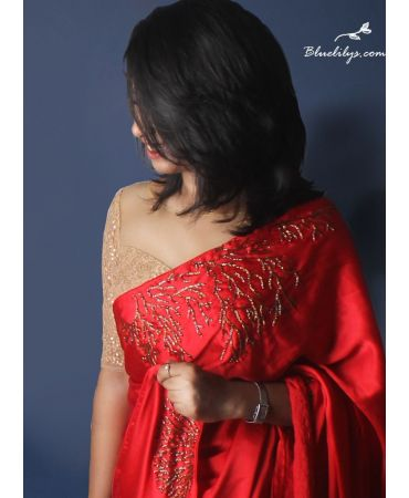 Beautiful premium quality satin red saree with very elegant hand-embroidery